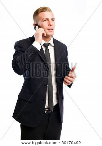 Successful Young Businessman On His Cellphone.