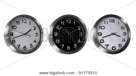 set of three wall clocks isolated on white