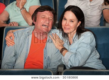 Woman Consoles Weeping Man