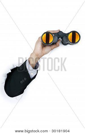 Businessman holding a binocular