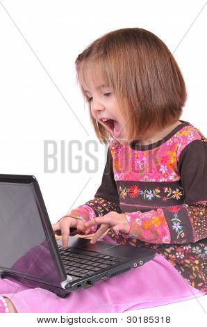 Beautiful little girl with laptop