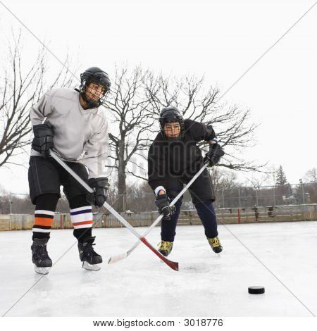 Boys Playing Ice Hockey.