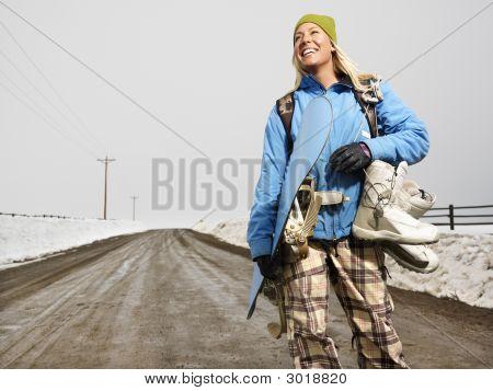 Woman Going Snowboarding.