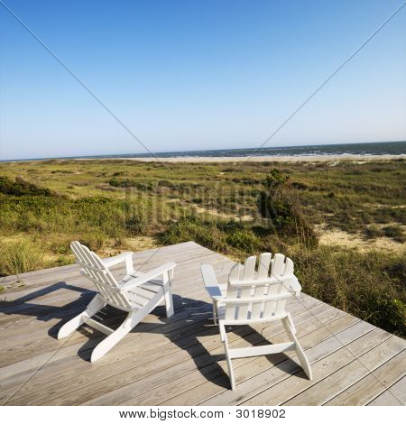 Deck Chairs On Beach.