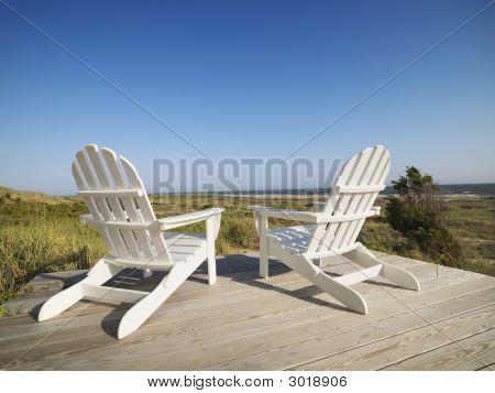 Deck Chairs At Beach.