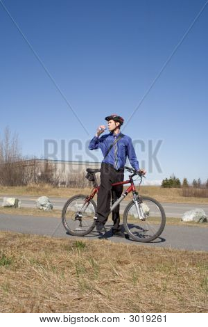 Business Man Drinking Water On Bicycle