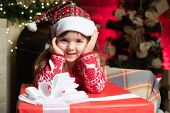 Girl Baby Christmas Eve. Cute Little Child Girl Play Near Christmas Tree. Kid Enjoy Winter Holiday A poster