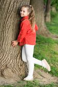 Girl Little Cute Child Enjoy Peace And Tranquility At Tree Trunk. Calm And Peaceful. Life Balance. P poster