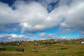 Country Landscape With Farmhouses Under Cloudy Sky In Torshavn, Denmark. Beautiful Landscape View. H poster