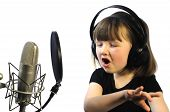 foto of singing  - little girl engrossed in recording a song - JPG