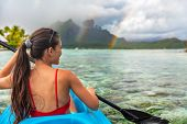 Kayak woman watersport activity tourist enjoying kayaking in Bora Bora at Mount Otemanu, Tahiti, Fre poster