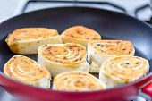 Close Up Of Fresh Grilled Tortilla Wraps With Filling. Fried Tortilla Rolls In A Pan. Selective Focu poster