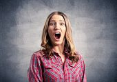 Scared Young Woman Screaming With Panic. Emotional Girl Has Frightened Facial Expression. Portrait O poster
