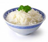 image of staples  - Bowl of Rice on White Background with parsley - JPG