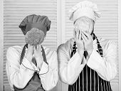Couple Cooks Hold Cabbage And Broccoli In Front Of Face. Healthy Food Concept. Couple Cooking Health poster