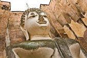 picture of chums  - The closeup image of Phra Atchana the big image of Buddha in Sri Chum temple the Sukhothai Historic Park Thailand - JPG