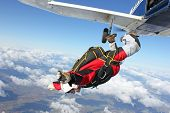 Skydivers jumps from an airplane