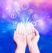 stock photo of healing hands  - female hands with seven symbol of chakra like a conncept for healing energy - JPG