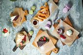 Assorted Sweet Desserts. Top View. Gray Textured Background. Beautiful Serving Dishes. Dessert. Food poster