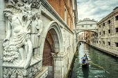 Venice Cityscape With Ancient Sculpture, Italy. Tourist Gondolas Sail Under Famous Bridge Of Sighs.  poster