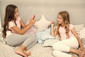 Selfie Of Modeling Of Kids - Two Little Girls Making Selfie On Smartphone. Little Girls Kids Modelin poster