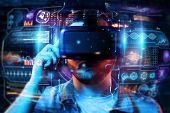 Portrait Of A Man With Glasses Of Virtual Reality, Vr, Interacts With A Virtual Screen. The Concept poster