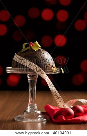 Festive Christmas pudding with ribbon and baubles
