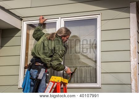 Window Washer Using Squeegee