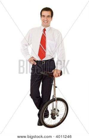 Balance In Business - Businessman With Monocycle