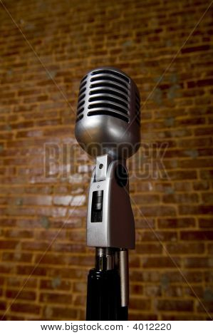 Vintagemicrophone In Front Of Brick Wall