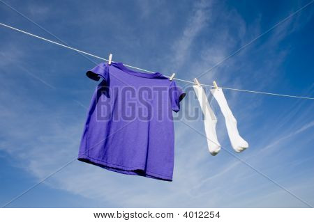 Purple T-Shirt And Socks On Clothesline
