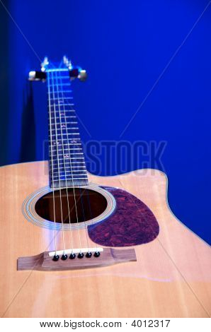 Acoustic Guitar Close Up Isolated On Blue Bk