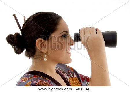 Side Pose Of Female Watching Through Binocular
