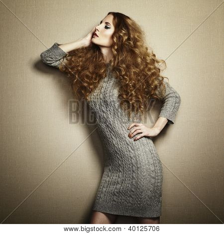 Portrait Of Beautiful Woman In Knitted Dress