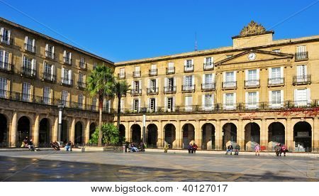 BILBAO, SPAIN - NOVEMBER 14: Plaza Nueva on November 14, 2012 in Bilbao, Spain. The main building, formerly site of the Biscay government, is now the site of the Basque language Royal Academy