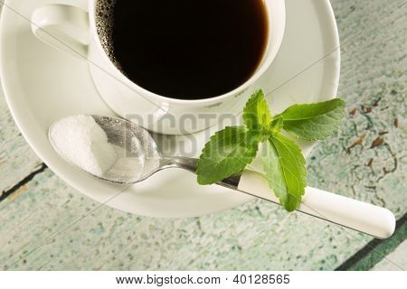 Highkey image of a cup of coffee with natural sweetener stevia