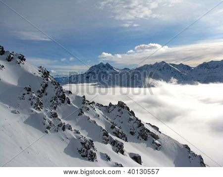 clouds in a valley in Alps