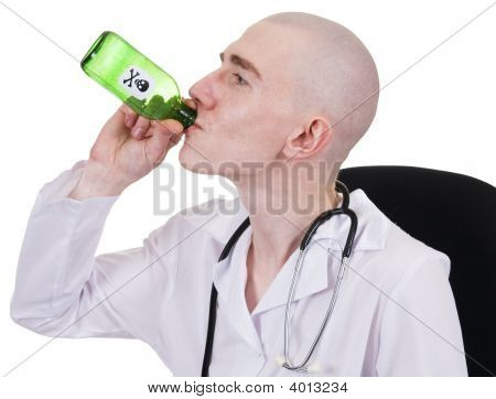 Man In Doctors Smock With Green Bottle