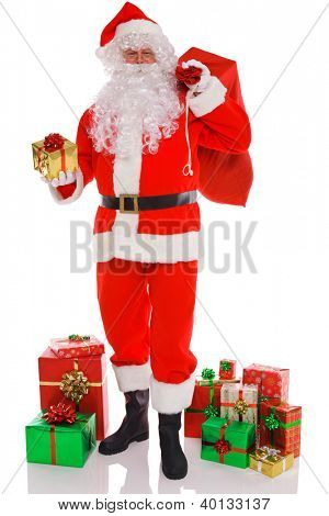 Santa Claus holding a sack full of gift wrapped presents ready to deliver, isolated on a white background.