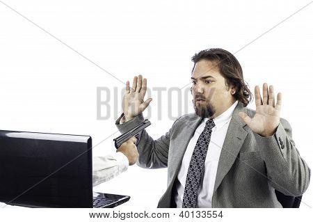Man On Computer With Gun