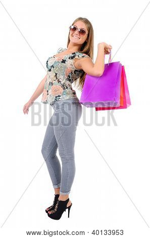 Isolated young casual woman holding shopping bag