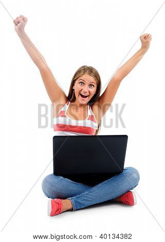 Isolated young casual woman using laptop