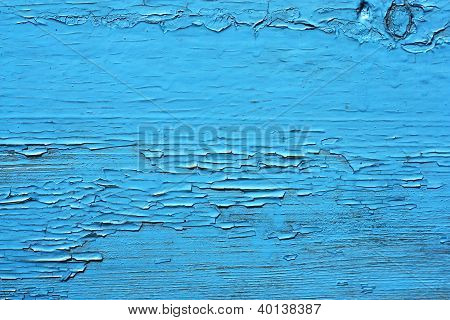 Closing On Blue Wooden Panels Of The Fence