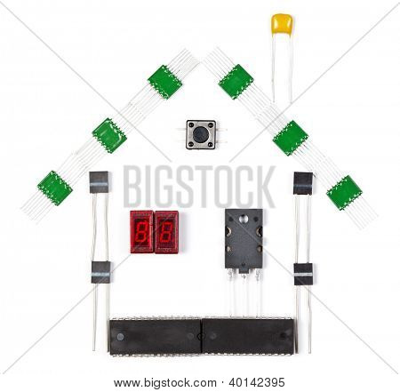 House made of electronic components on white background