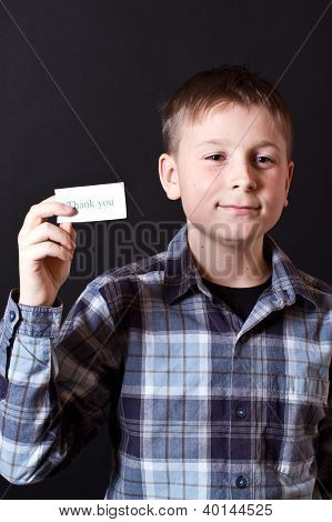 Boy Shows A Card With Gratitude