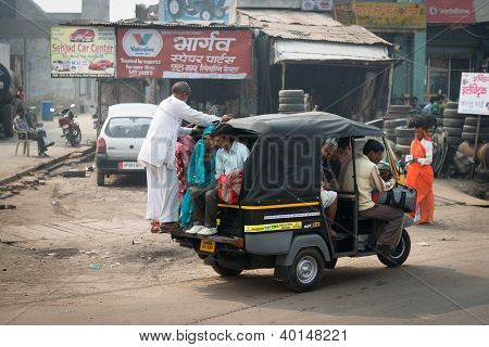Overloaded Indian Tuk Tuk On Typical Messy Street, India