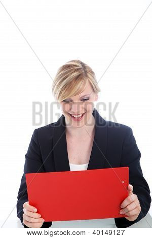 Elated Woman Reading Notes On A Clipboard