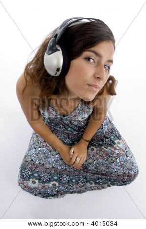 High Angle View Of Young Female With Headphone