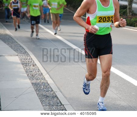 Hangzhou, China - Nov 9, 2008: A Male Marathon Runner Leading A Group
