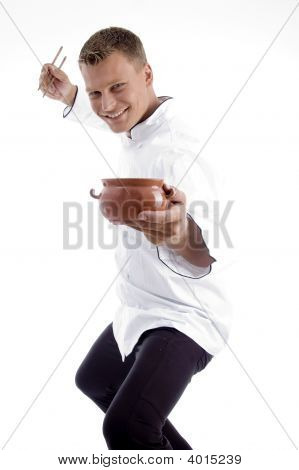 Handsome Chef Posing With Utensils